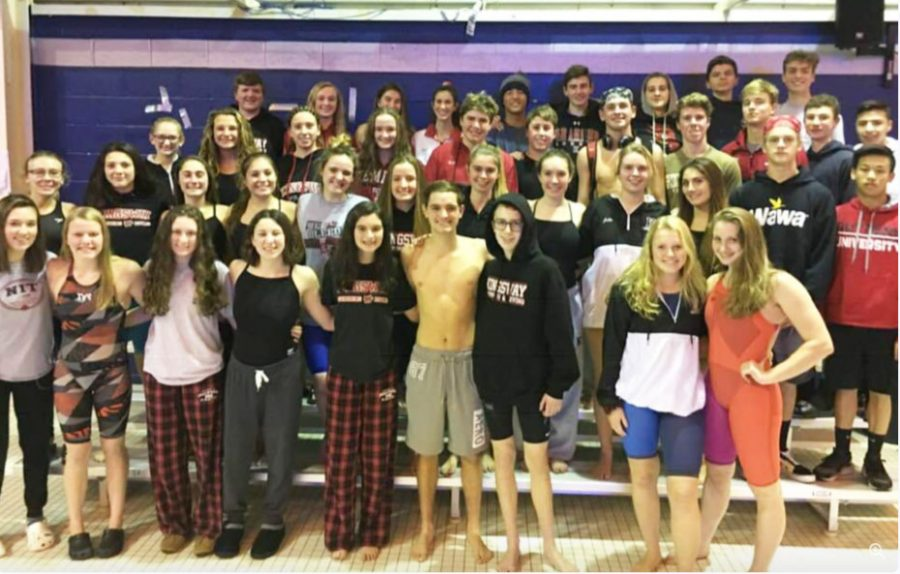 The team paused briefly for a parent picture before their great swims against rival GCIT.