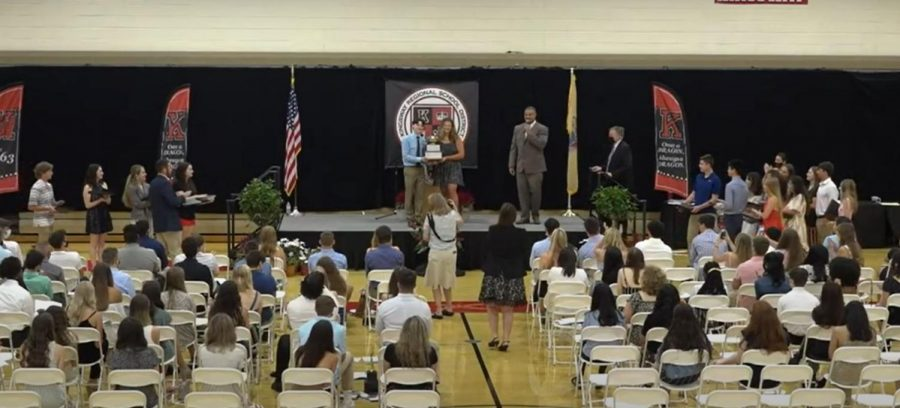 Seniors of the Year, Julia Nocentino and Cole Griscom hold up the Senior of the Year cup for all award winners, and staff to view. It will be returned to the display case in the main lobby of the school once their names are added to the list of other winners.